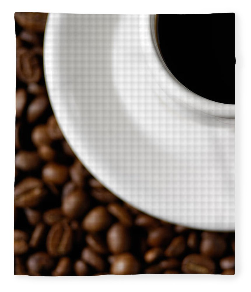 Cup Fleece Blanket featuring the photograph Cup Of Black Coffee On Coffee Beans by Maxim Images Prints