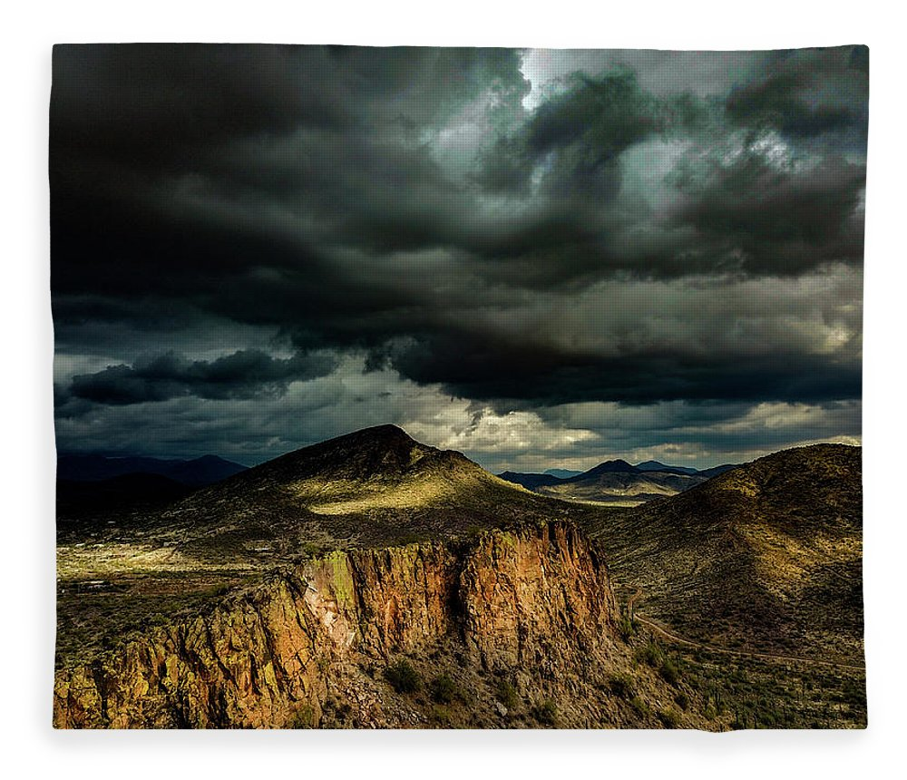 Drone Photography Fleece Blanket featuring the photograph Dark Storm Clouds Over Cliffs by David Stevens