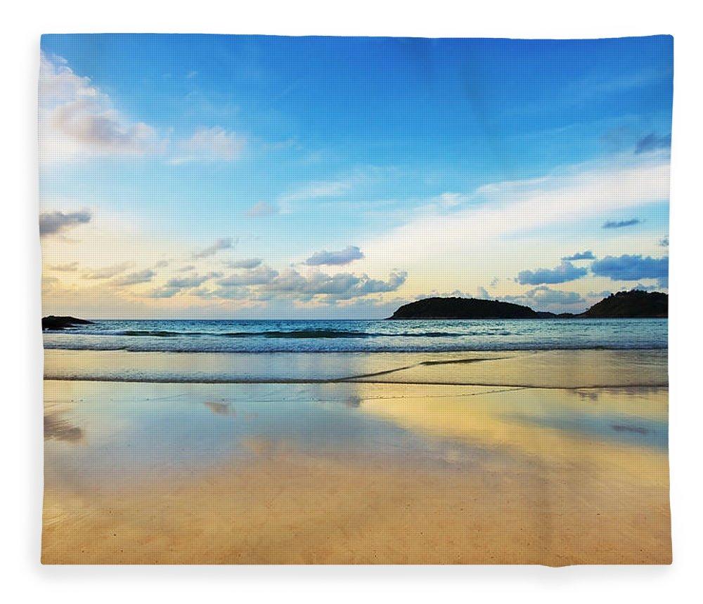 Area Fleece Blanket featuring the photograph Dramatic Scene Of Sunset On The Beach by Setsiri Silapasuwanchai
