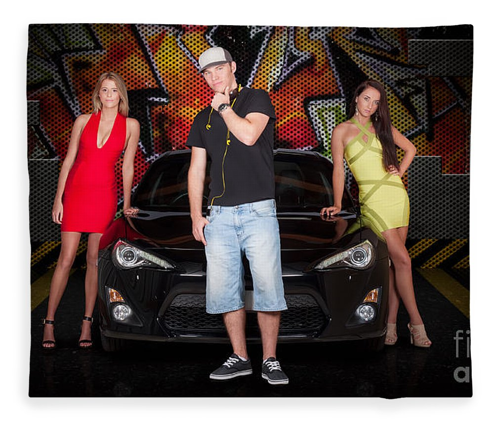 People Fleece Blanket featuring the photograph Group Of Young People Beside Black Modern Car by Jorgo Photography - Wall Art Gallery