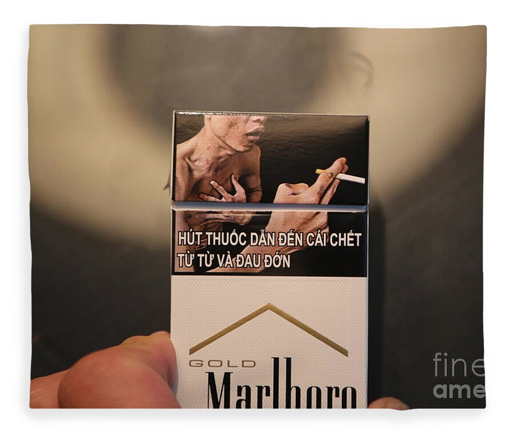 Vietnam Fleece Blanket featuring the photograph Marlboro Cigarettes Pkg Vietnam by Chuck Kuhn