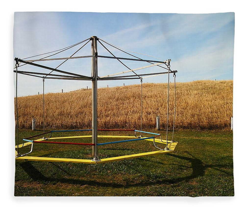 Playground Fleece Blanket featuring the photograph Merry Go Round On The Prairie by Jeff Swan