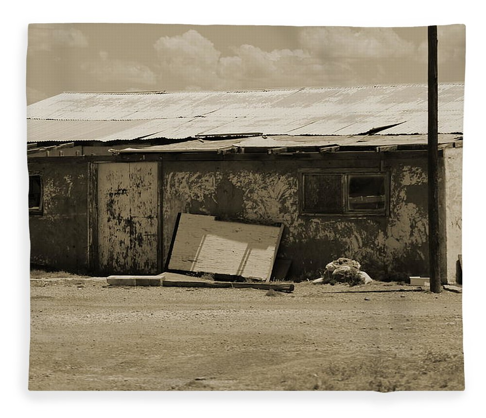 Sepia Fleece Blanket featuring the photograph Old Rundown Building in Sepia Tones by Colleen Cornelius