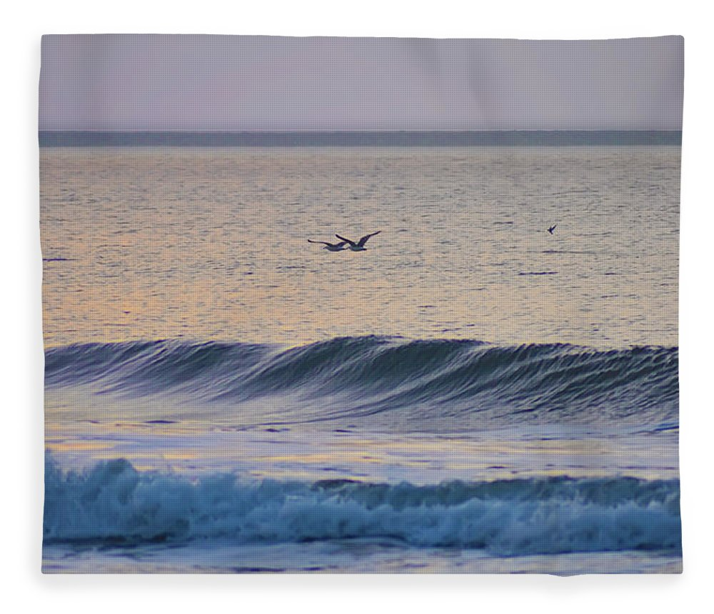 Seagulls Fleece Blanket featuring the photograph Over The Waves by Bill Cannon