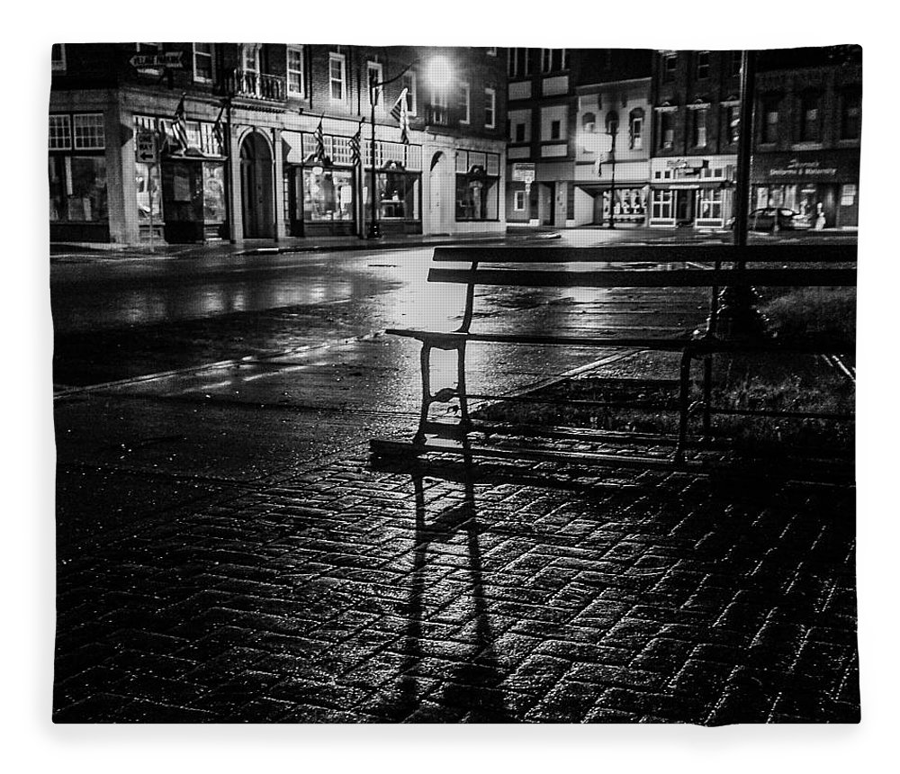 Fleece Blanket featuring the photograph Park bench on a rainy night by Kendall McKernon