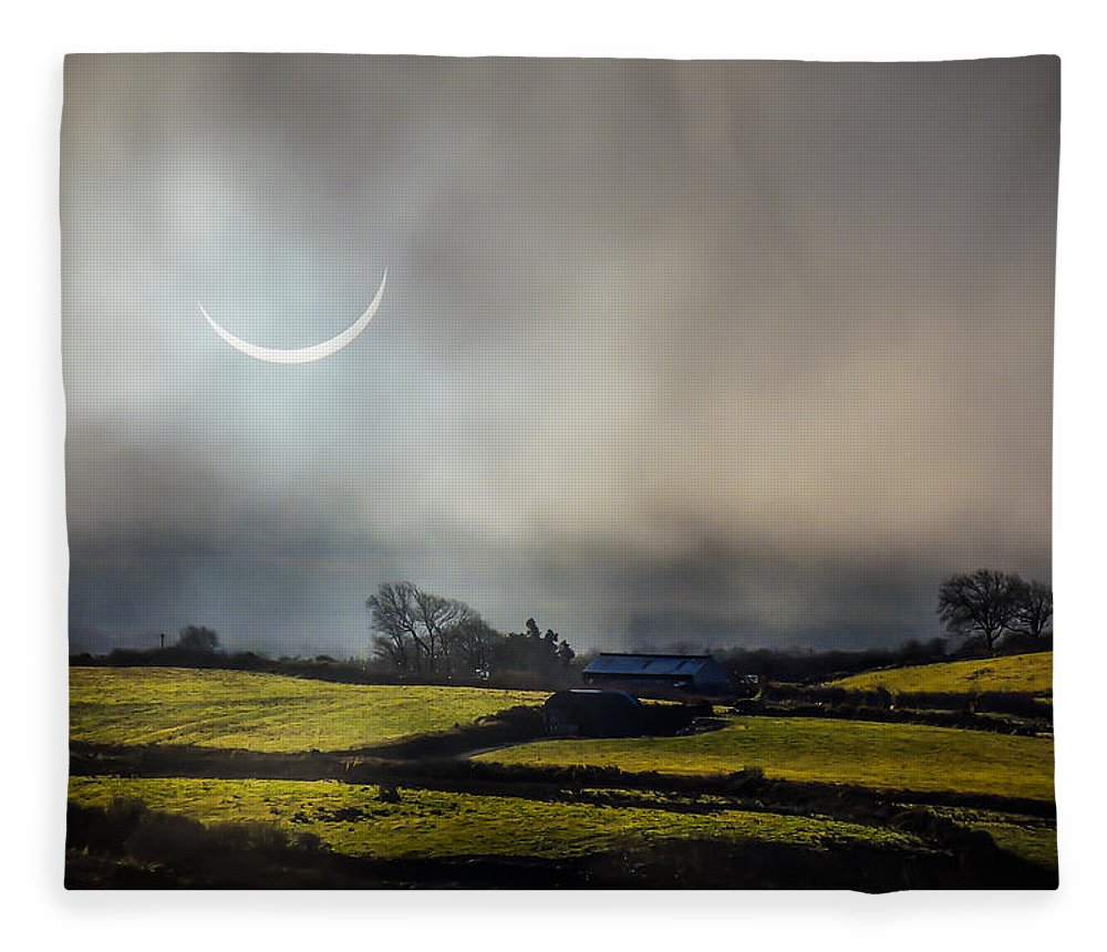 Ireland Fleece Blanket featuring the photograph Solar Eclipse Over County Clare Countryside by James Truett
