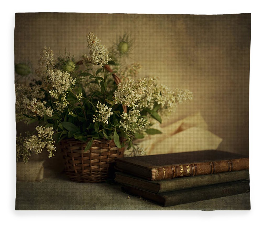 Still Life With Old Books And White Flowers In The Basket Fleece