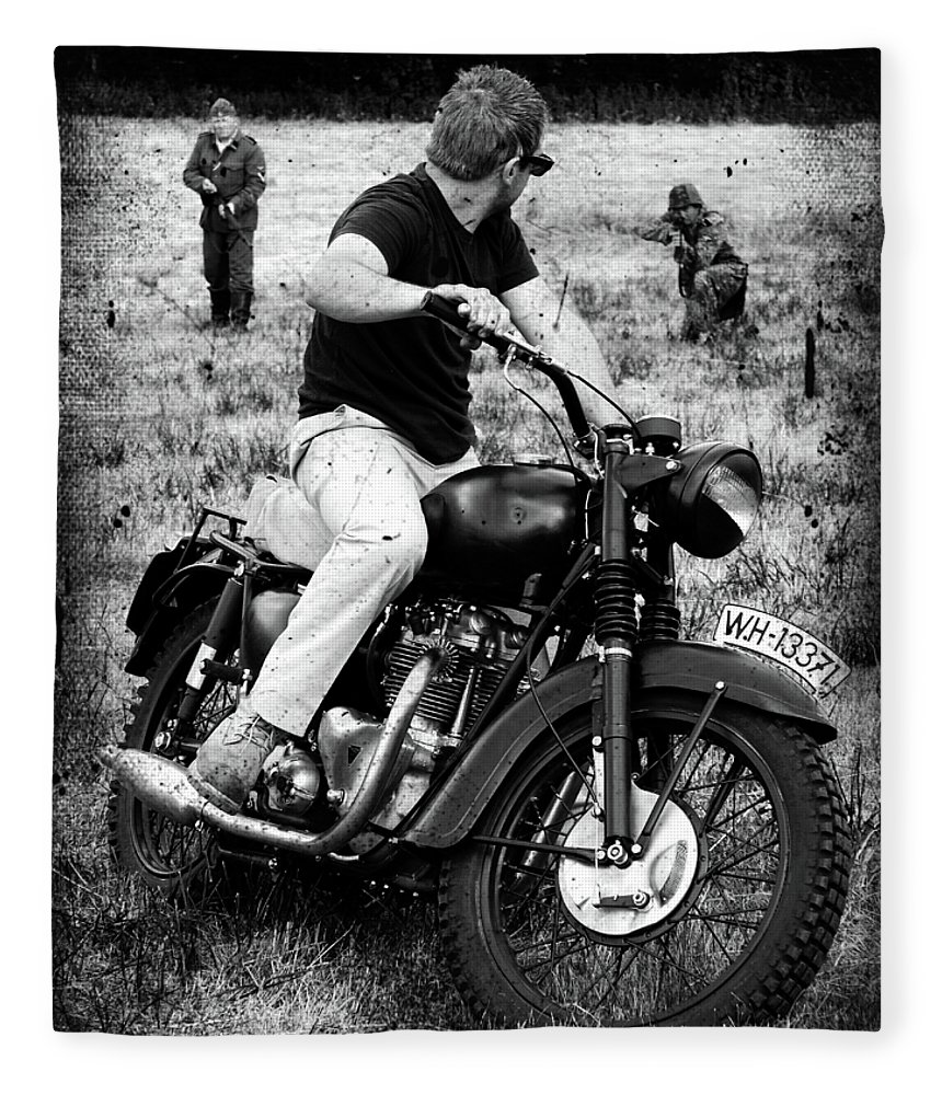 Triumph Fleece Blanket featuring the photograph The Great Escape by Mark Rogan