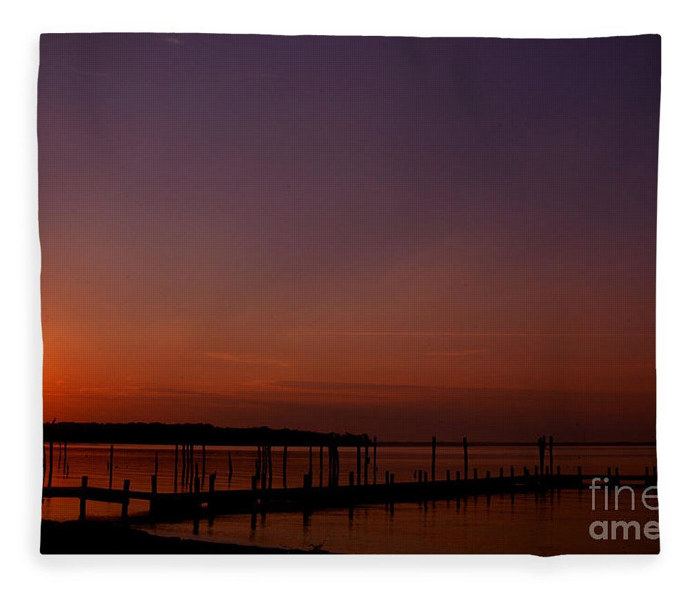 Clay Fleece Blanket featuring the photograph The Sun Sets Over The Water by Clayton Bruster