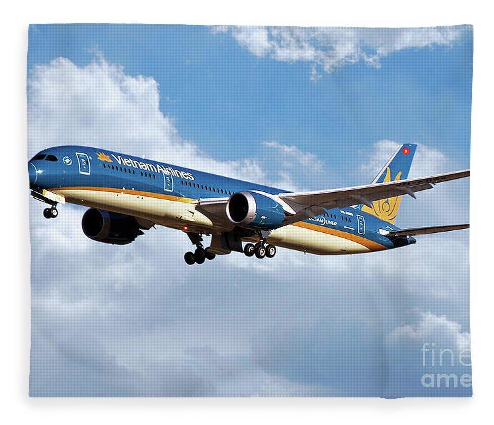 Boeing Fleece Blanket featuring the digital art Vietnam Airlines Boeing 787 Dreamliner by J Biggadike