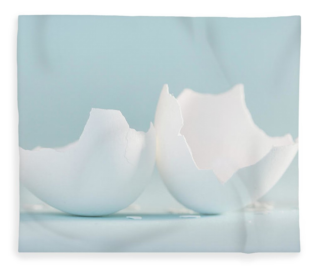 Chicken Egg Fleece Blanket featuring the photograph White Egg Shell On Soft Blue by Iris Richardson