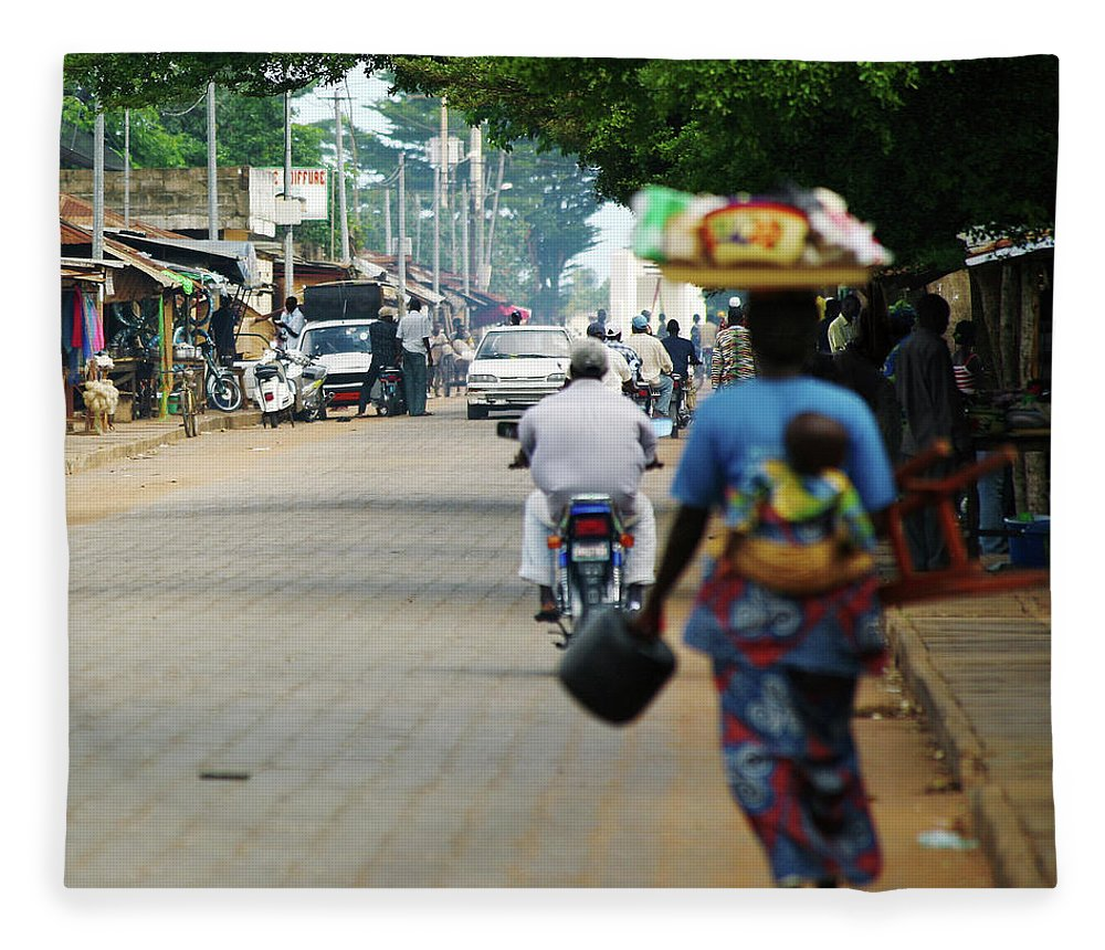 Trading Fleece Blanket featuring the photograph African Street Scene by Peeterv