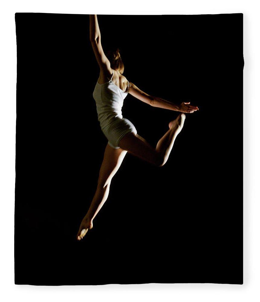 Ballet Dancer Fleece Blanket featuring the photograph Ballet And Contemporary Dancers by John Rensten