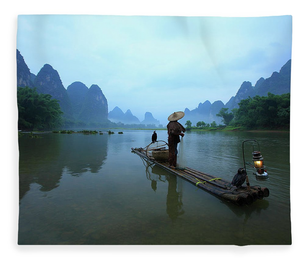 Chinese Culture Fleece Blanket featuring the photograph Fisherman On Li River by Bihaibo
