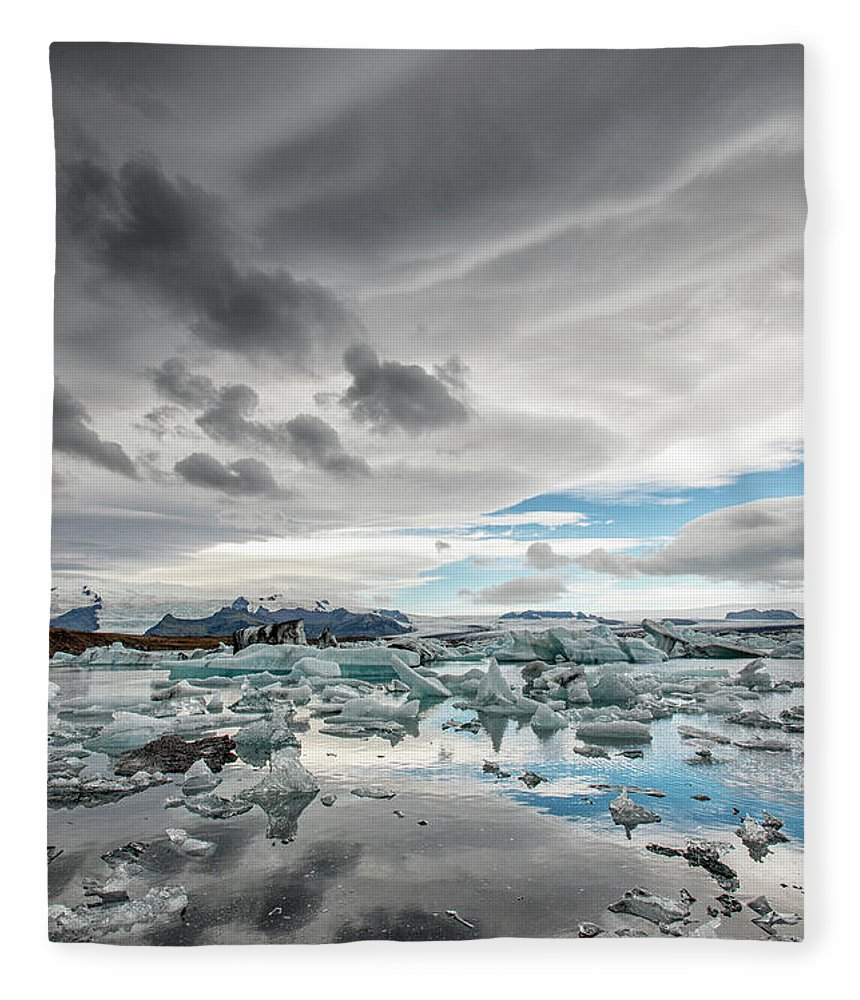 Scenics Fleece Blanket featuring the photograph Icebergs In Glacial Lagoon With Stormy by Mike Hill