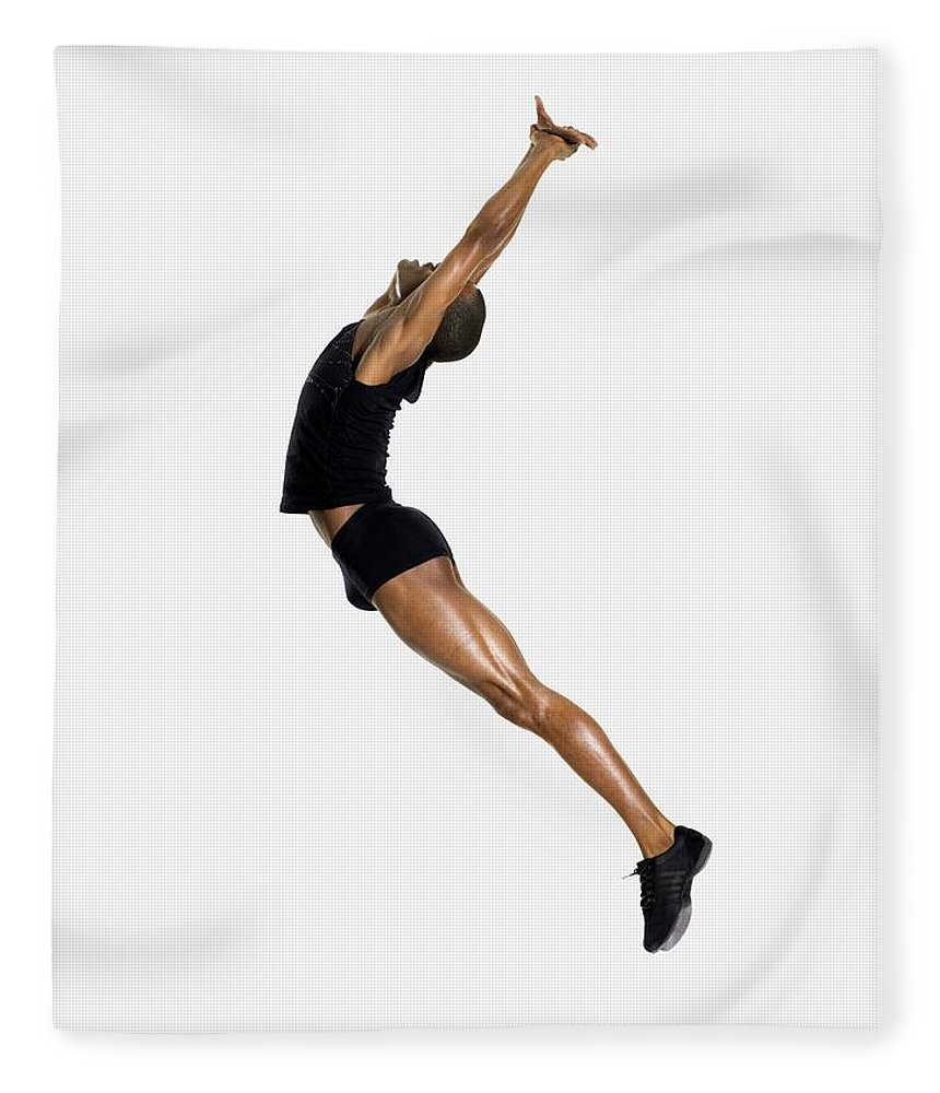 Young Men Fleece Blanket featuring the photograph Male Dancer Jumping by Image Source