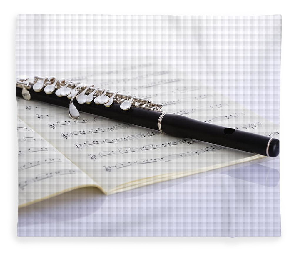 Sheet Music Fleece Blanket featuring the photograph Piccolo On A Score by Imagenavi