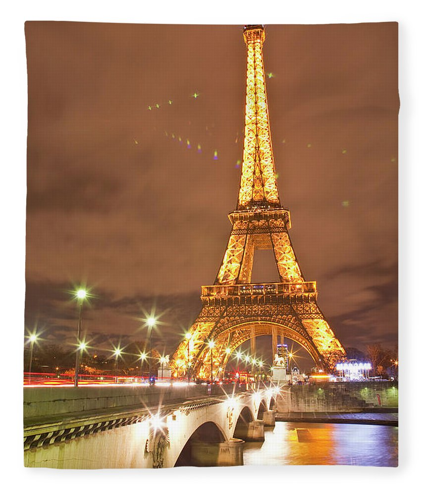 In A Row Fleece Blanket featuring the photograph The Eiffel Tower Lit Up At Night In by Julian Elliott Photography