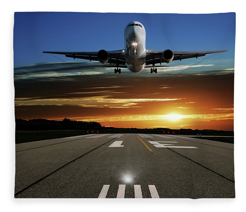 Orange Color Fleece Blanket featuring the photograph Xl Jet Airplane Landing At Sunset by Sharply done