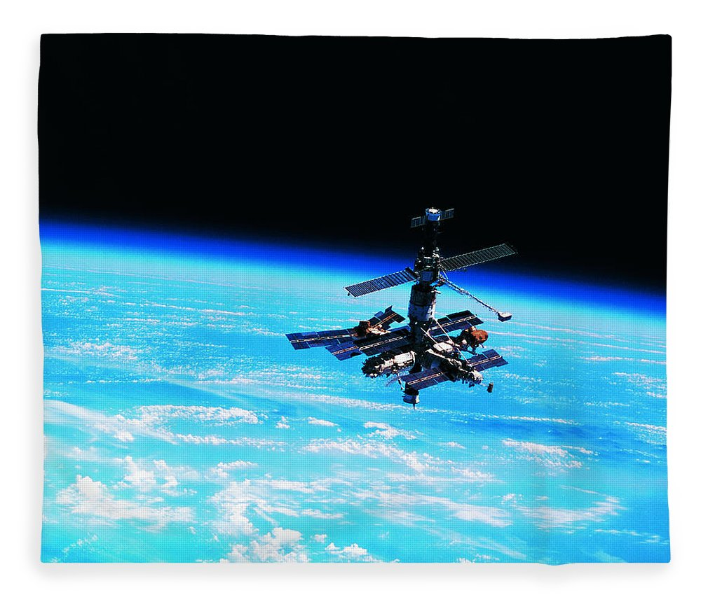 Alertness Fleece Blanket featuring the photograph A Space Station Orbiting Above Earth by Stockbyte