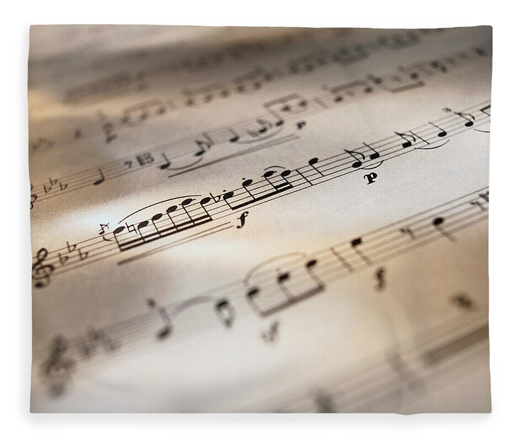 Sheet Music Fleece Blanket featuring the photograph Detail Of Sheet Music by Ryan Mcvay