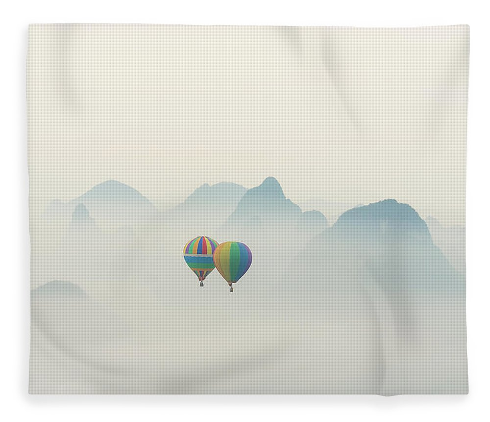 Scenics Fleece Blanket featuring the photograph Hot Air Balloon Ride At Dawn Over Karst by Alex Linghorn