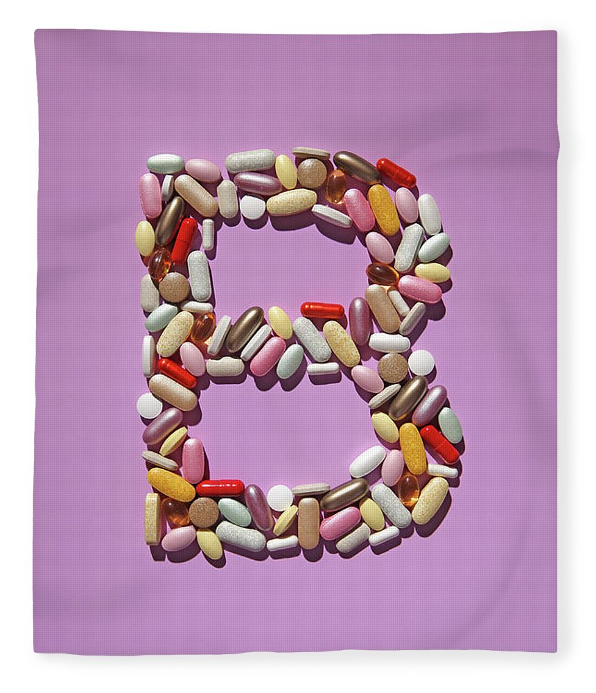 Vitamin Fleece Blanket featuring the photograph Multi-vitamin Pills And Capsules by Nicholas Eveleigh