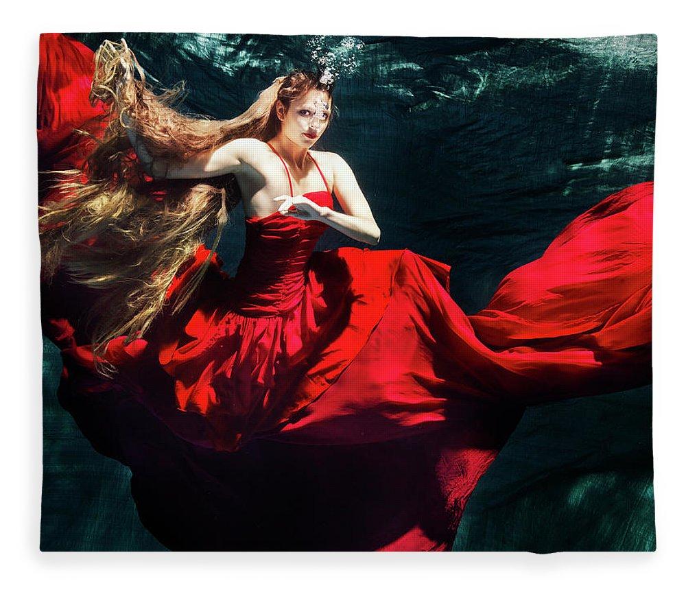 Ballet Dancer Fleece Blanket featuring the photograph Female Dancer Performing Under Water by Henrik Sorensen