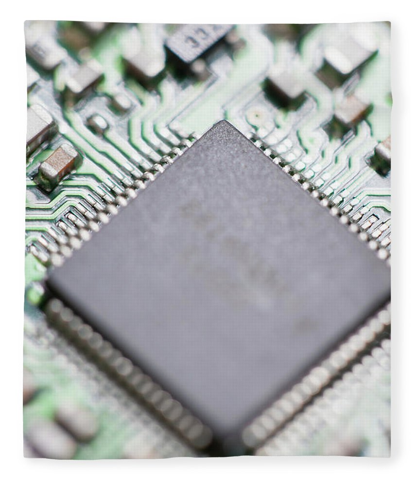 Electrical Component Fleece Blanket featuring the photograph Close-up Of A Circuit Board by Nicholas Rigg
