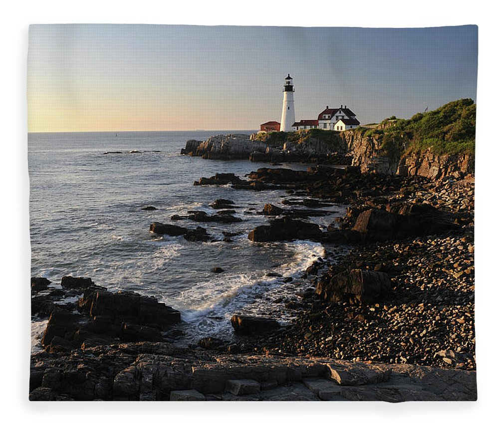 Water's Edge Fleece Blanket featuring the photograph Portland Head Light by Aimintang