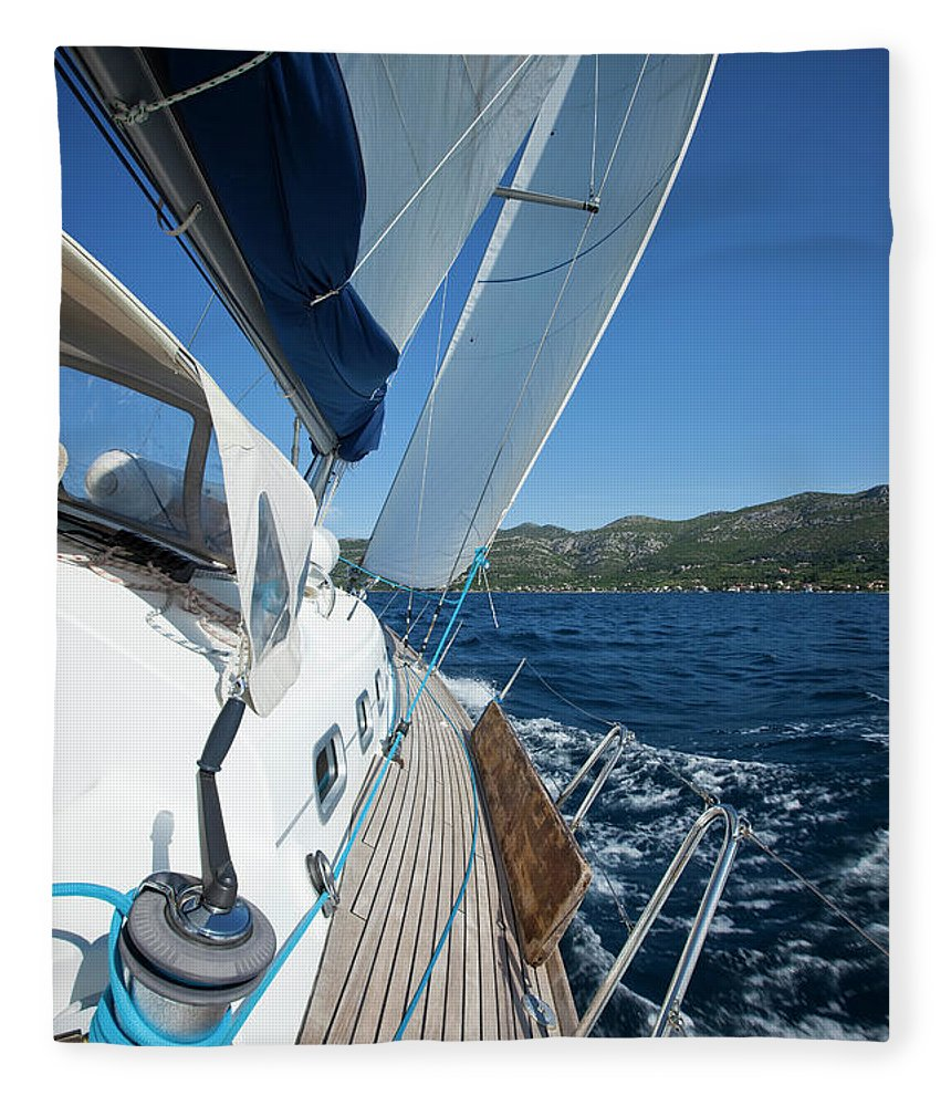 Curve Fleece Blanket featuring the photograph Sailing In The Wind With Sailboat by Mbbirdy