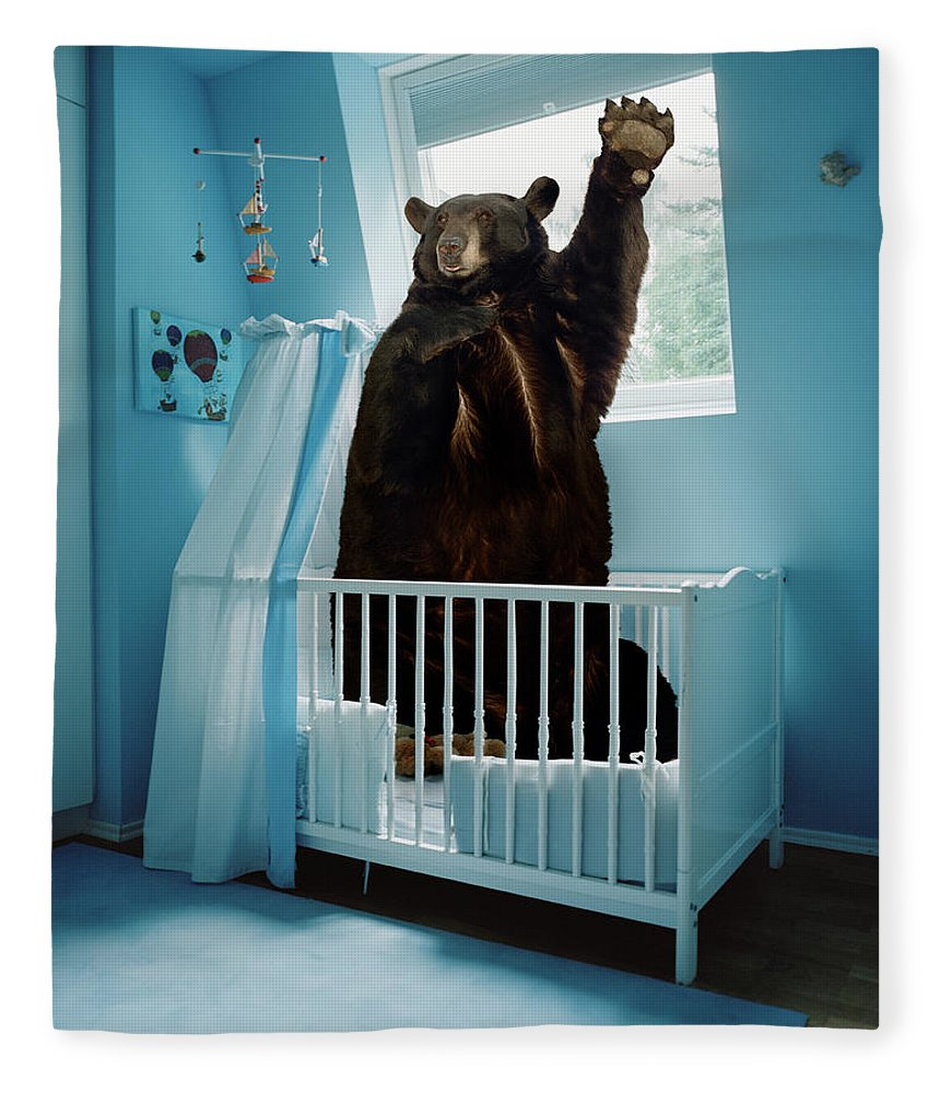 Out Of Context Fleece Blanket featuring the photograph A Bear Inside A Crib In A Blue Room by Matthias Clamer