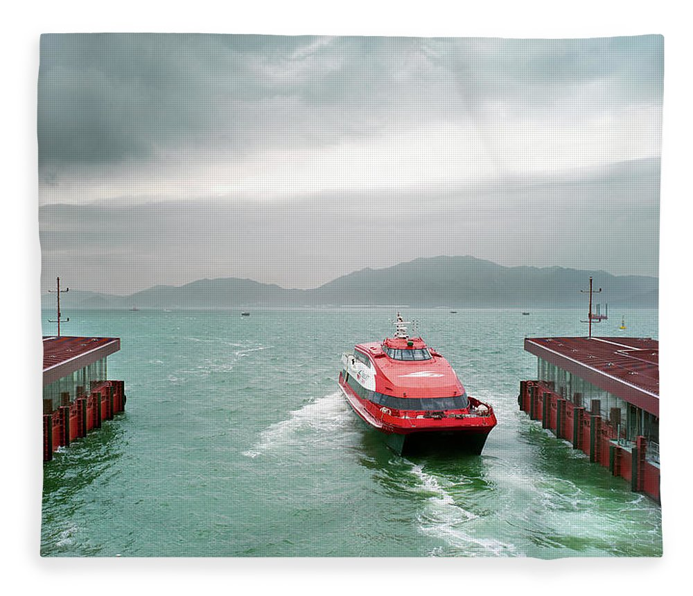 Macao Fleece Blanket featuring the photograph A Catamaran Ferry Docks At A Port by Xpacifica