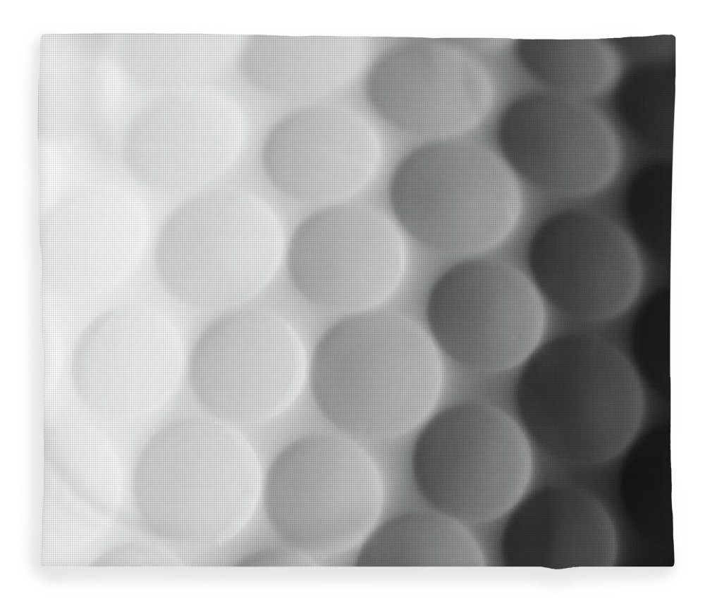 Ball Fleece Blanket featuring the photograph A Close Up Shot Of A Golf Ball, White by Anthiacumming