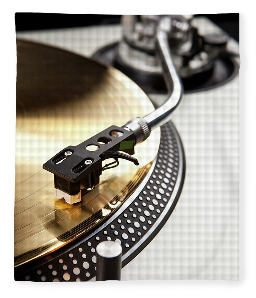 Music Fleece Blanket featuring the photograph A Gold Record On A Turntable by Caspar Benson