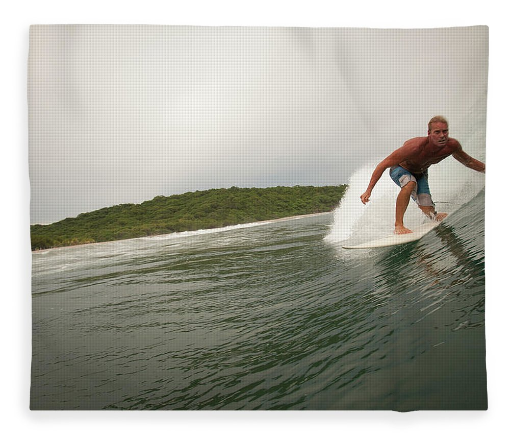 Focus Fleece Blanket featuring the photograph A Male Surfer In A Barrel Of A Wave In by Sean Murphy