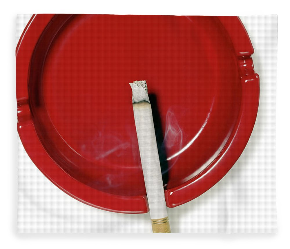 White Background Fleece Blanket featuring the photograph A Red Ashtray With A Burning Cigarette by Steve Wisbauer