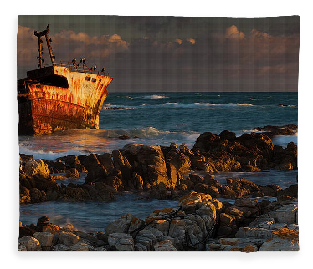 Non-urban Scene Fleece Blanket featuring the photograph A Rusting Wreck, An Abandoned Ship Off by Mint Images - Art Wolfe
