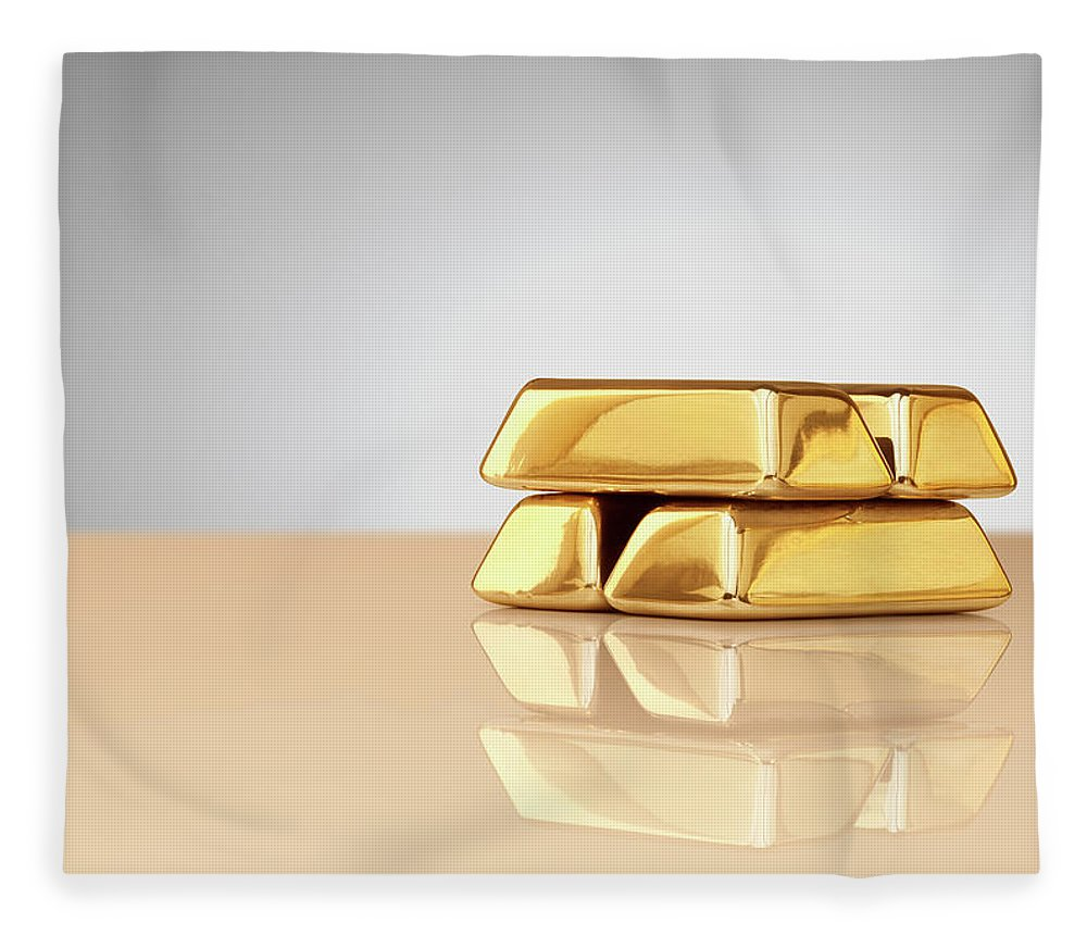 Four Objects Fleece Blanket featuring the photograph A Stack Of Four Gold Ingots by Anthony Bradshaw