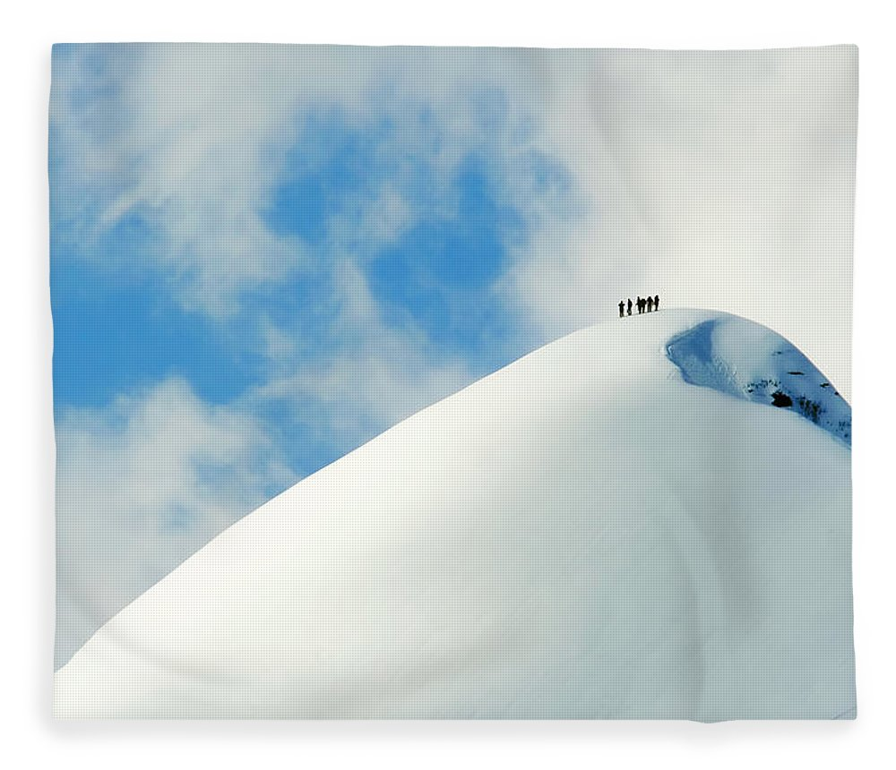 The End Fleece Blanket featuring the photograph A Team Of People Climbing A Snowy by Lopurice