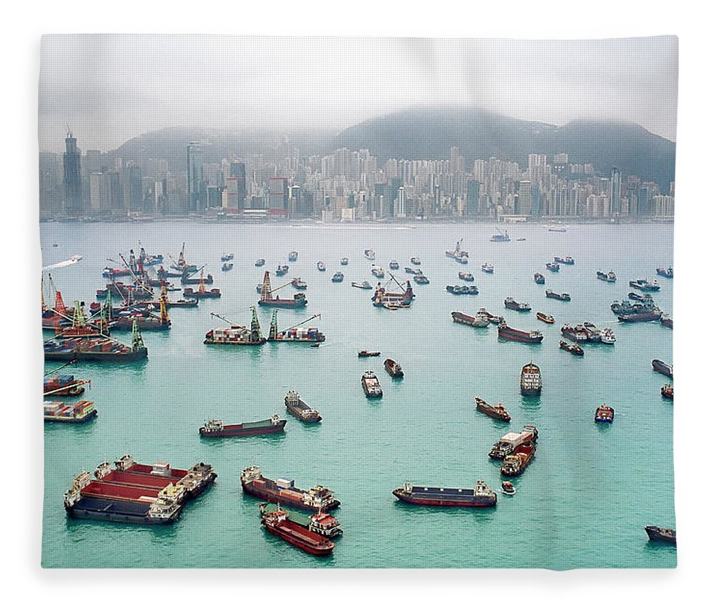 Trading Fleece Blanket featuring the photograph A View Of Hong Kong Harbor Through A by Xpacifica