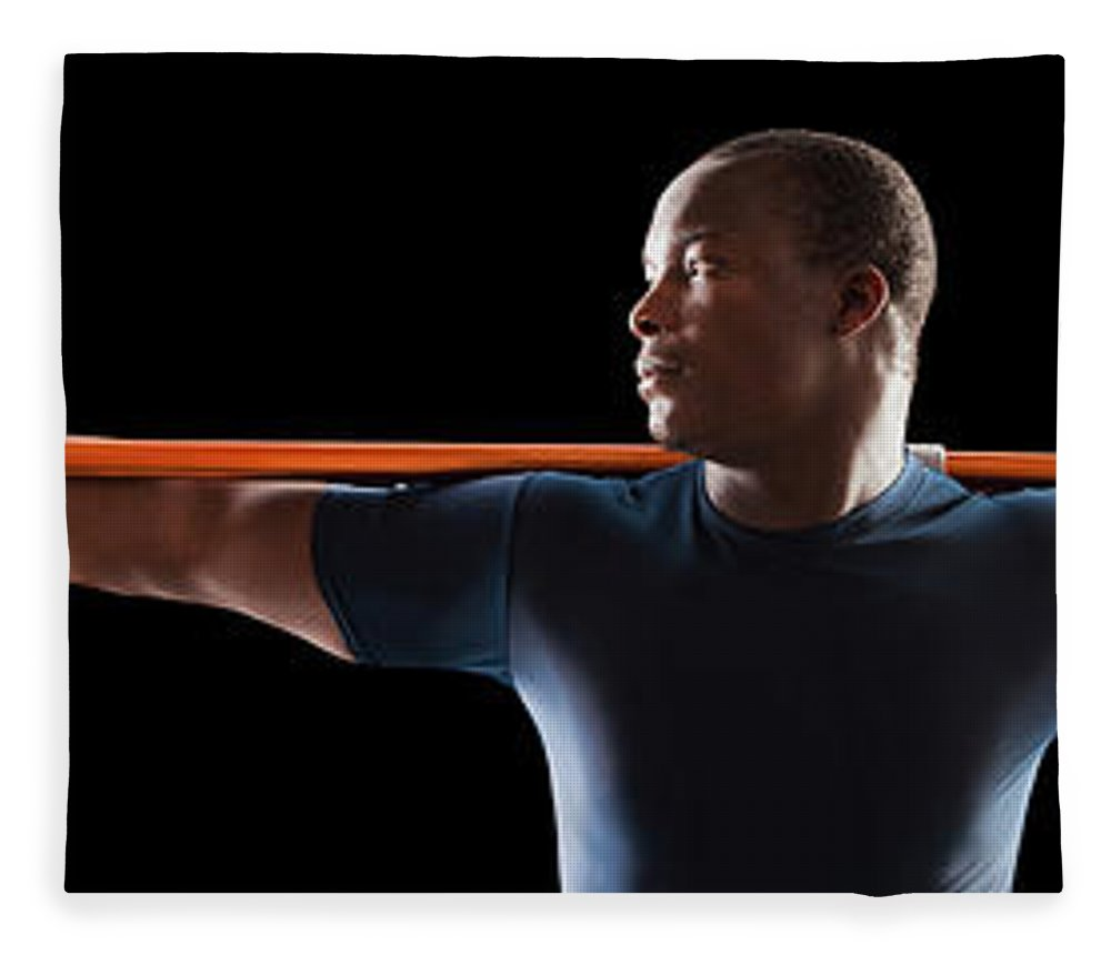 Young Men Fleece Blanket featuring the photograph African American Man Holding Track And by Mike Kemp