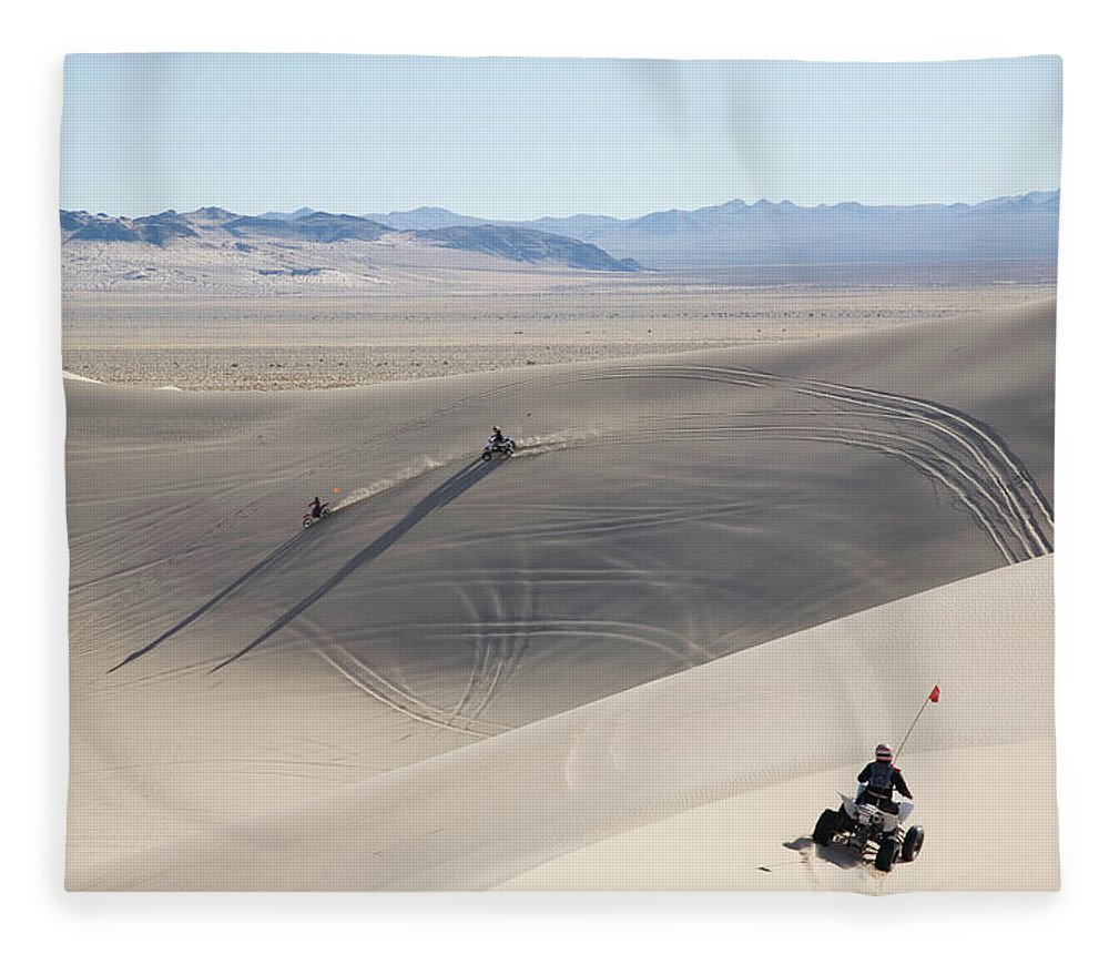 Caucasian Ethnicity Fleece Blanket featuring the photograph All Terrain Motorcycles Driving Over by Per Breiehagen