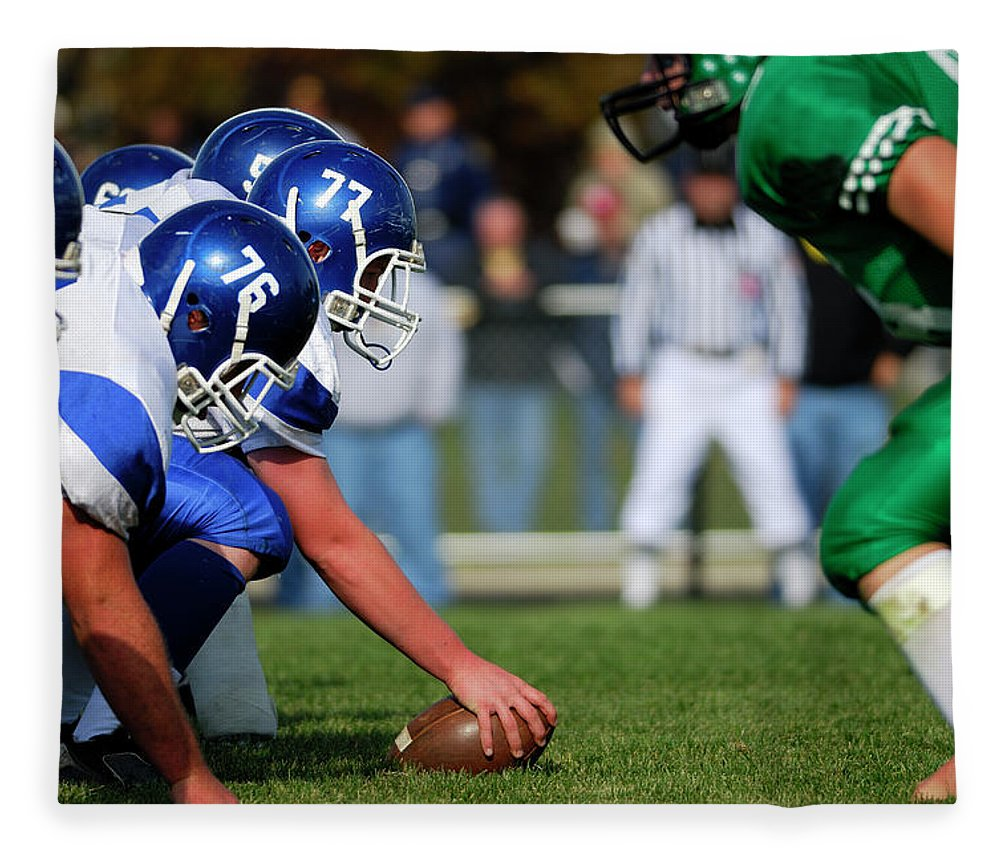 Sports Helmet Fleece Blanket featuring the photograph American Football Line Of Scrimmage by Groveb