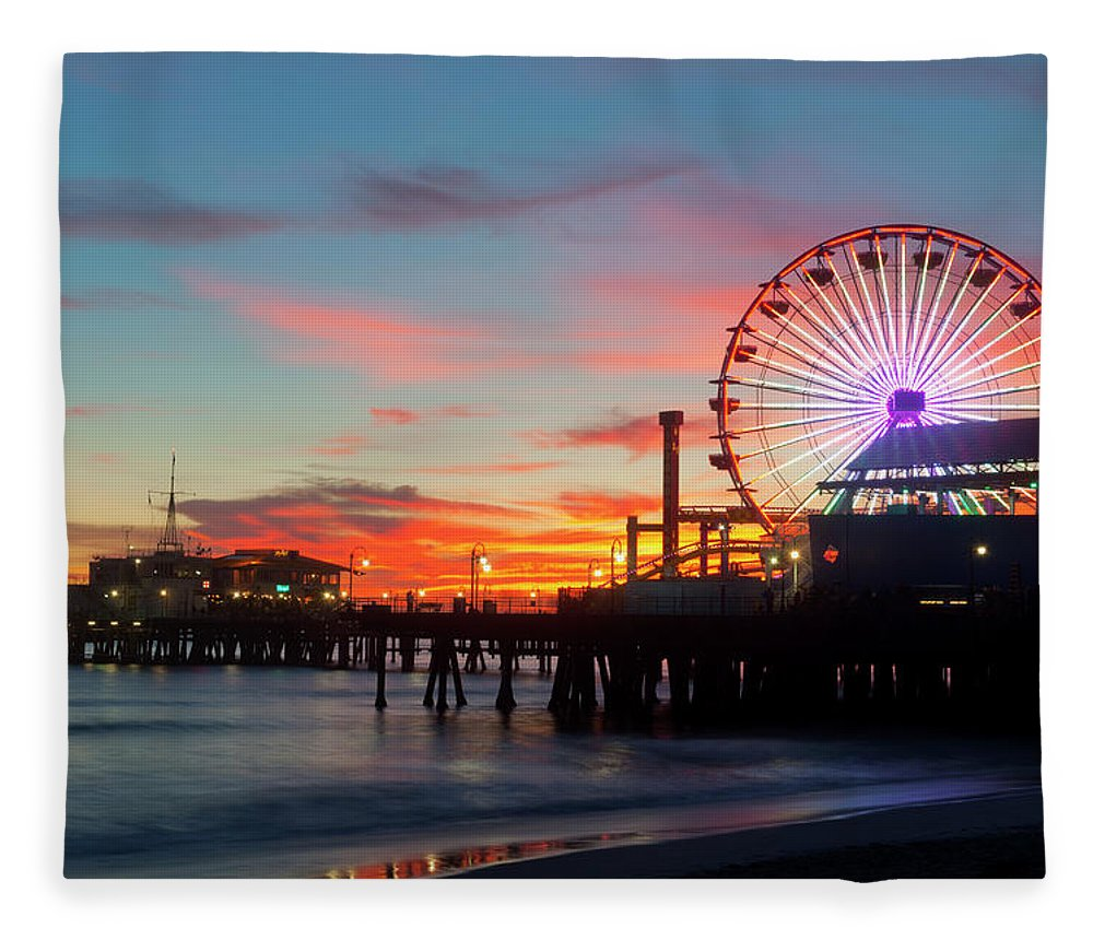 Scenics Fleece Blanket featuring the photograph Amusement Park On Waterfront At Night by Blend Images/pete Saloutos