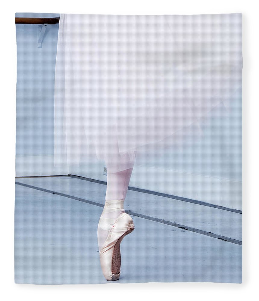 Expertise Fleece Blanket featuring the photograph Ballerina On Pointe Low Angle View by Jonya