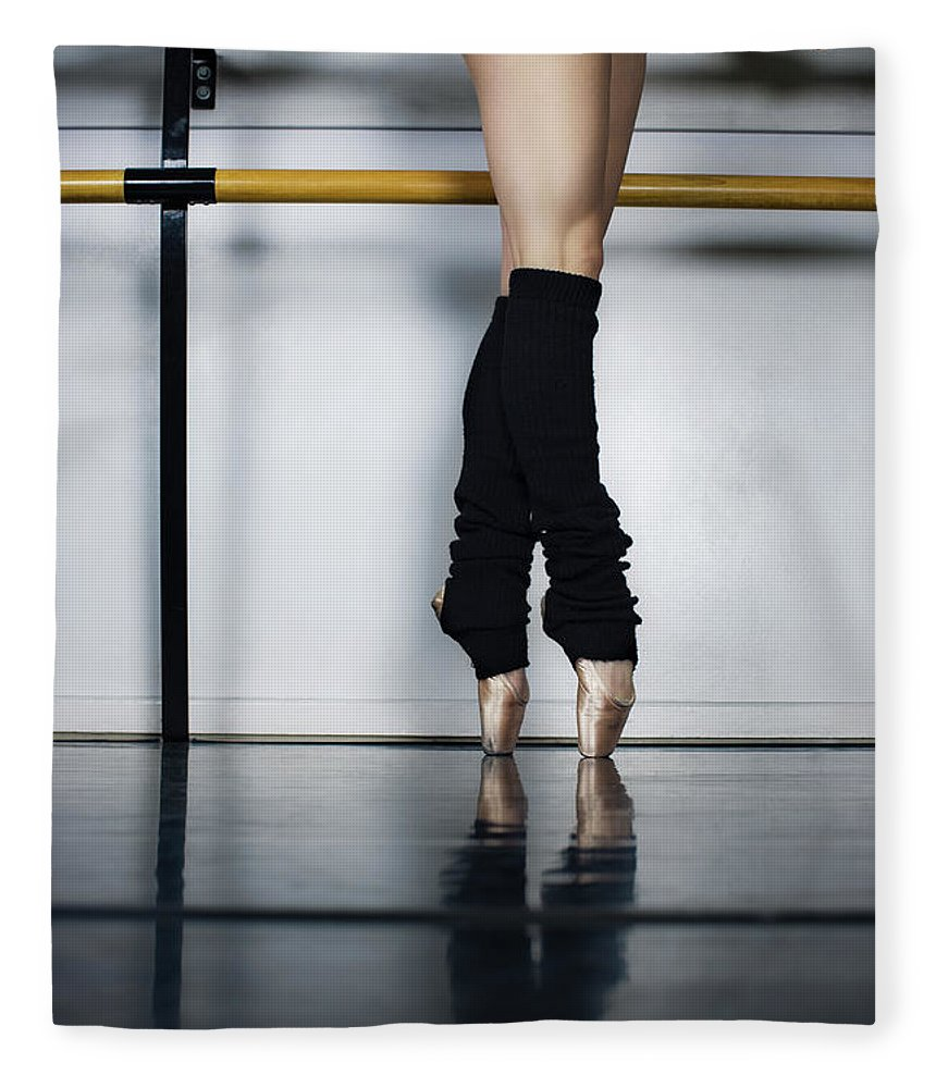 Ballet Dancer Fleece Blanket featuring the photograph Ballet Holdiing Bar In Classic Pointe by Patrik Giardino