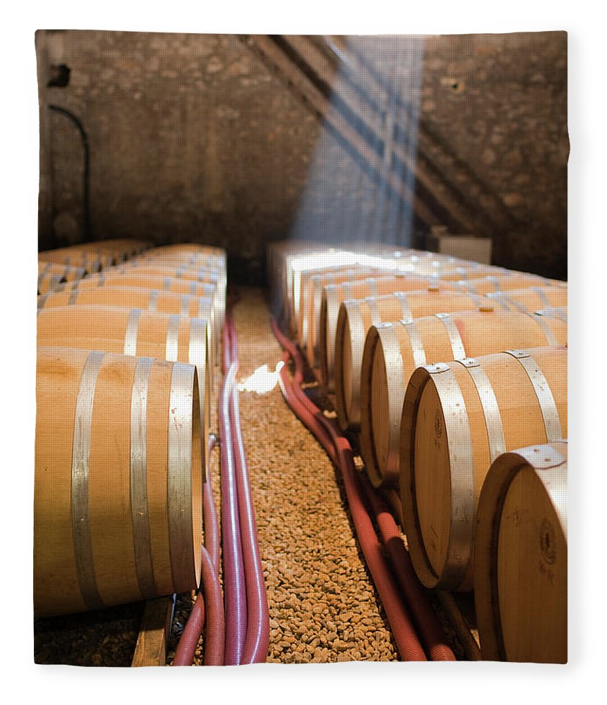 Alcohol Fleece Blanket featuring the photograph Barrels In Wine Cellar by Johner Images