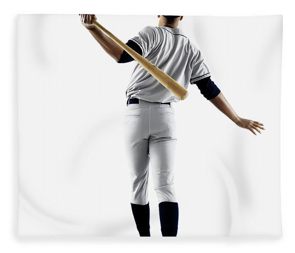 Baseball Cap Fleece Blanket featuring the photograph Baseball Player Hitting Home Run From by Patrik Giardino