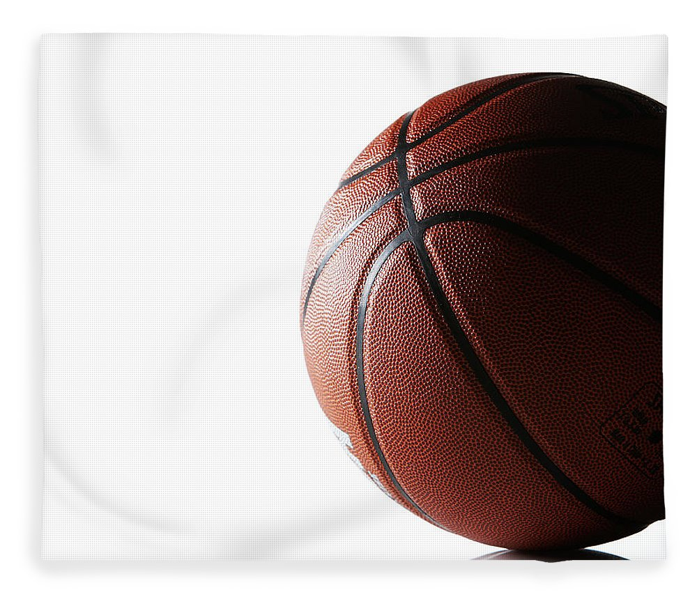 Recreational Pursuit Fleece Blanket featuring the photograph Basketball On White Background by Thomas Northcut